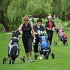 women-walking-the-golf-course